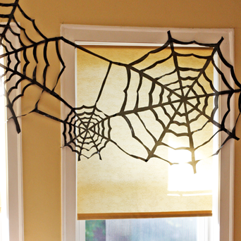 trash bag spider webs - Cheap Halloween Decor